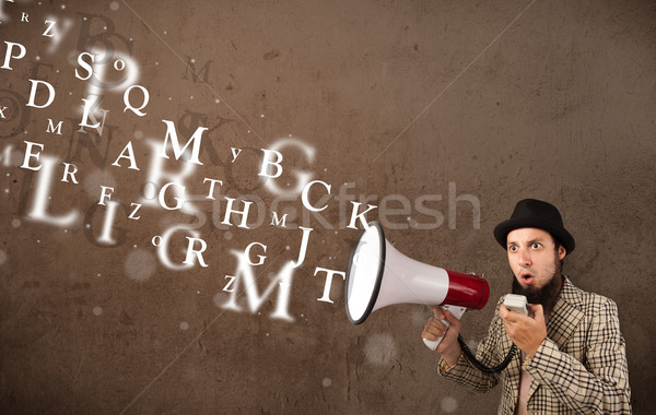 Stock photo: Man in shirt shouting into megaphone and text come out