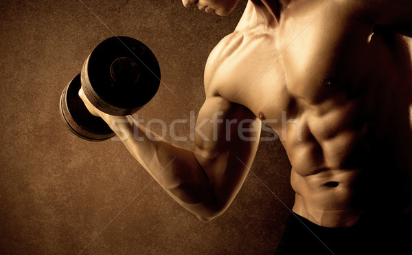 Stock photo: Muscular fit bodybuilder athlete lifting weight