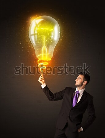 Businessman with an eco-friendly bulb Stock photo © ra2studio