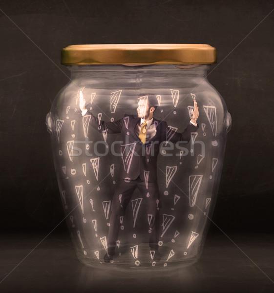 Om de afaceri prins borcan mână sticlă om de afaceri Imagine de stoc © ra2studio