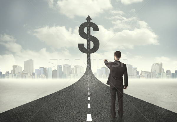 Business man on road heading toward a dollar sign Stock photo © ra2studio