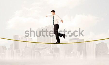 Balancing gouden touw jonge elegante Stockfoto © ra2studio