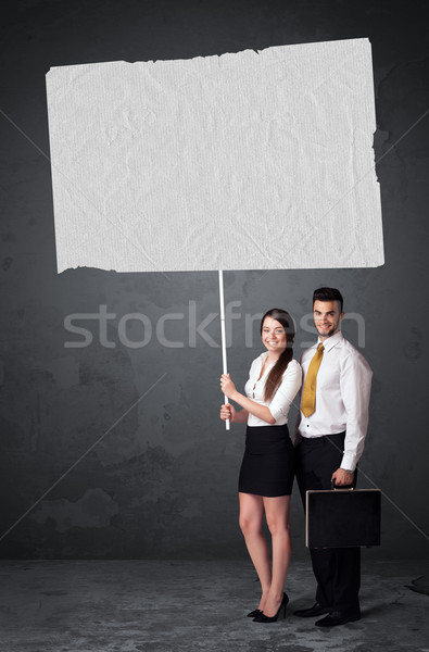 Business couple with blank booklet paper Stock photo © ra2studio