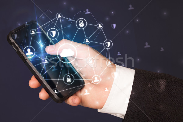 Hand using phone with centralized linked cloud system concept Stock photo © ra2studio