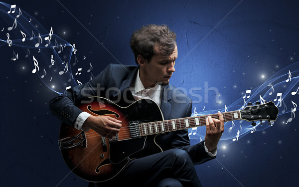 Lonely composer playing on guitar Stock photo © ra2studio