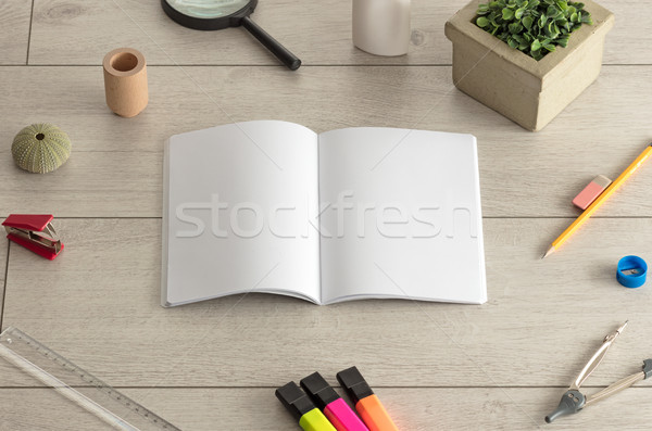 Notebook on the floor with office tools nearby Stock photo © ra2studio