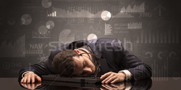 Businessman sleeping with charts, graphs and reports concept Stock photo © ra2studio