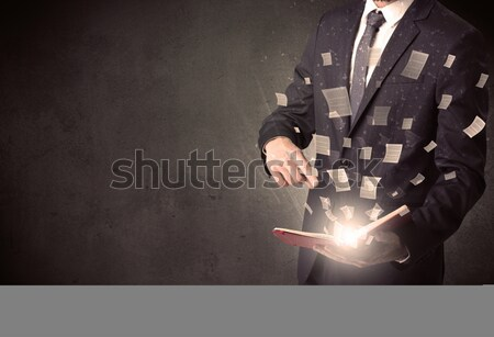 Businessman looking to inspiration in a magic ball and doodle concept Stock photo © ra2studio