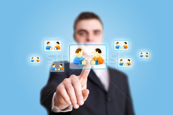 Stock photo: Businessman hand pressing Social network icon 2