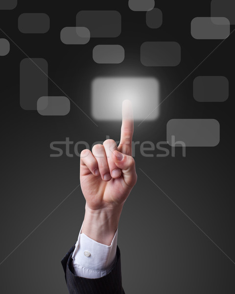 hand pressing a touchscreen button Stock photo © ra2studio