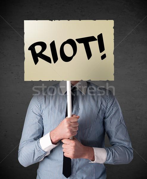 Empresario protesta signo demostración bordo Foto stock © ra2studio