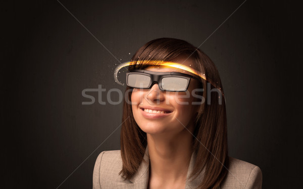 Stock photo: Pretty woman looking with futuristic high tech glasses