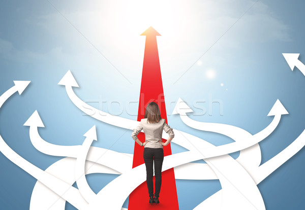 businesswoman with different direction arrows Stock photo © ra2studio