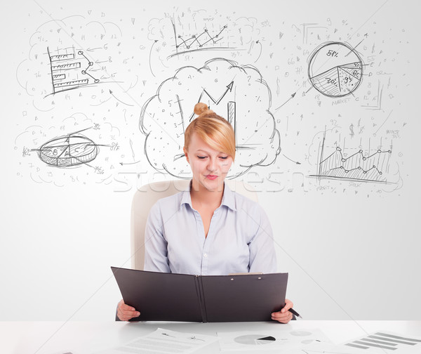 Business woman sitting at table with hand drawn graph charts Stock photo © ra2studio
