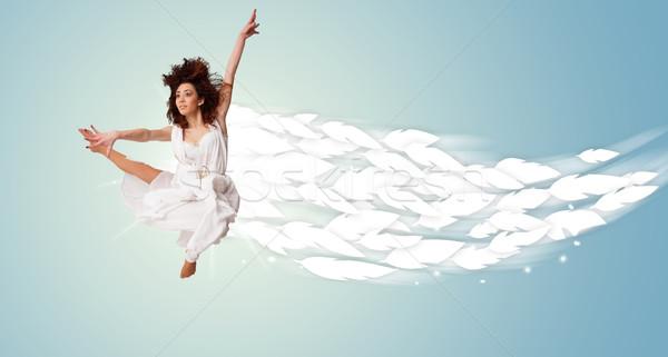 Saudável mulher jovem saltando em torno de brilhante Foto stock © ra2studio