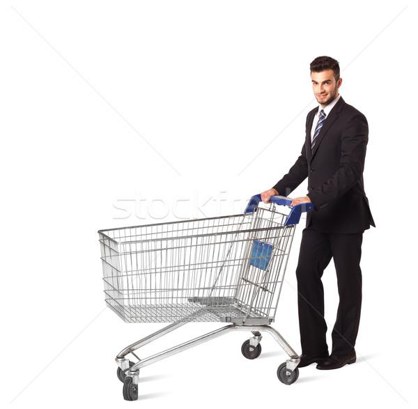 Biznesmen koszyk popychanie odizolowany garnitur rynku Zdjęcia stock © ra2studio