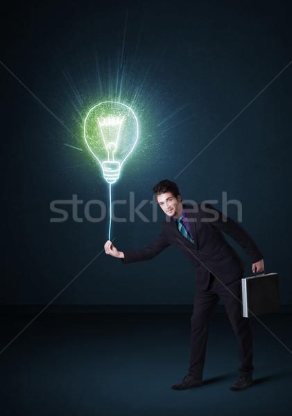 Businessman with an idea bulb Stock photo © ra2studio