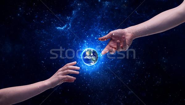 手 スペース 触れる 地球 男性 神 ストックフォト © ra2studio