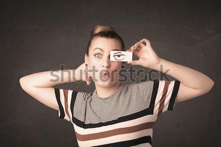 Cool młodzik patrząc papieru oczy Zdjęcia stock © ra2studio