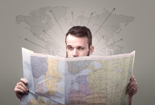 Junger Mann halten Karte gut aussehend Weltkarte Pfeile Stock foto © ra2studio