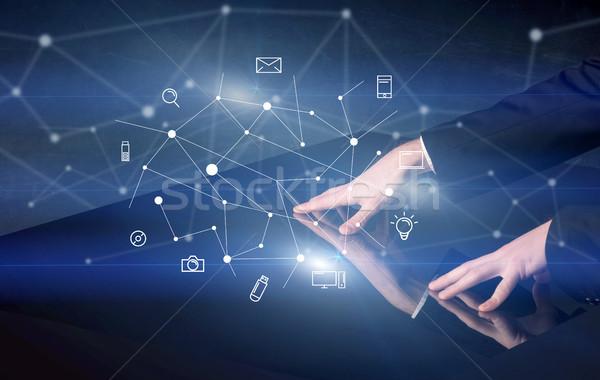 Mains toucher interactive table Homme bleu Photo stock © ra2studio