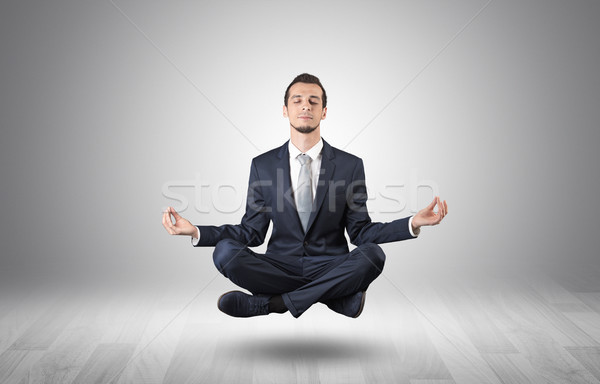 Geschäftsmann Sitzung Yoga Position leer Stock foto © ra2studio