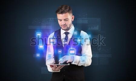 businessman holding virtual shield sign Stock photo © ra2studio