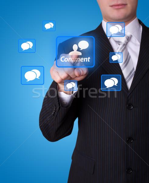 Stock photo: Man pressing social network button