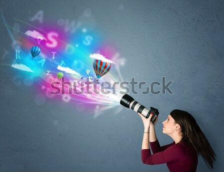 Worker with airbrush and colorful abstract clouds and balloons Stock photo © ra2studio