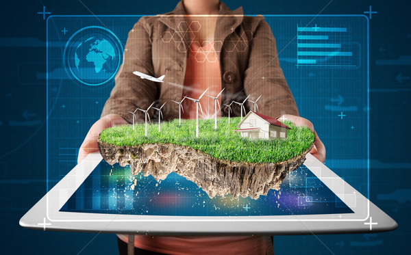 Young woman presenting a perfect ecology land with a house and windmills Stock photo © ra2studio