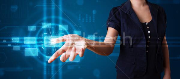Woman pressing high tech type of modern buttons  Stock photo © ra2studio