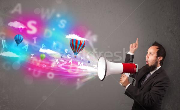 Férfi kiált megafon absztrakt szöveg léggömbök Stock fotó © ra2studio