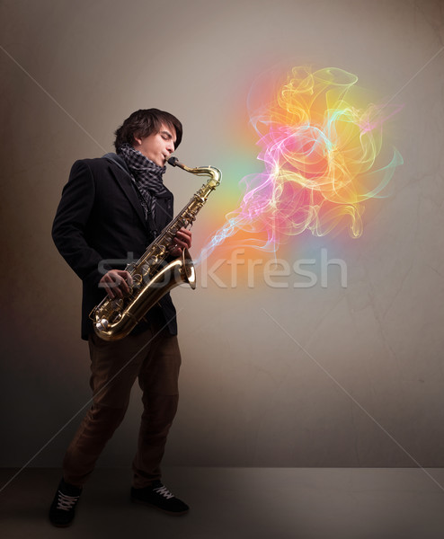 Atrakcyjny muzyk gry saksofon kolorowy streszczenie Zdjęcia stock © ra2studio