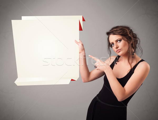 Young woman holding white origami paper copy space Stock photo © ra2studio