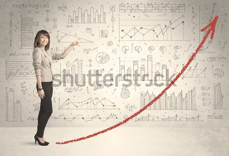 Business woman climbing on red graph arrow concept Stock photo © ra2studio