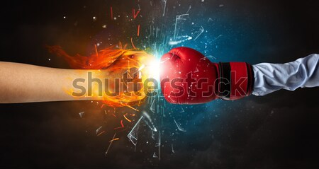 Bodybuilder athlete lifting weight with fire explode arm concept Stock photo © ra2studio
