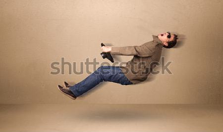 Happy funny man driving a flying car concept Stock photo © ra2studio