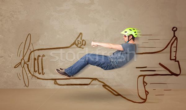 Drôle pilote conduite dessinés à la main avion mur Photo stock © ra2studio