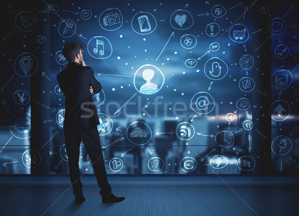 Stock photo: Businessman drawing social media connection scheme