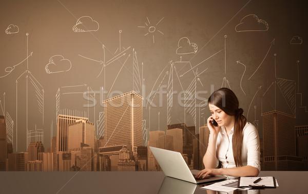 Сток-фото: деловая · женщина · зданий · сидят · черный · таблице · бумаги