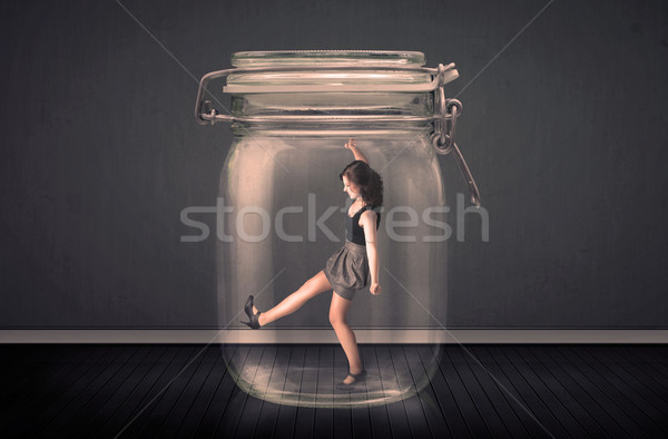 Stock photo: Businesswoman trapped into a glass jar concept