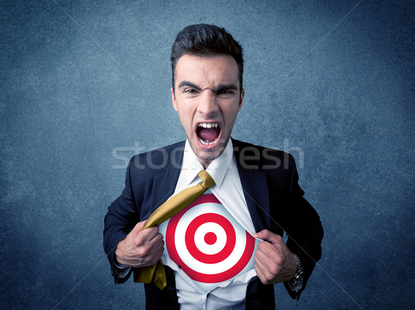Stock photo: Businessman tearing shirt with target sign on his chest