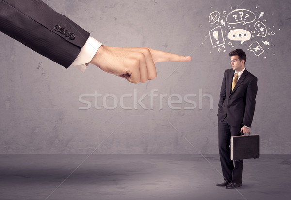 Stock photo: Boss hand pointing at confused employee