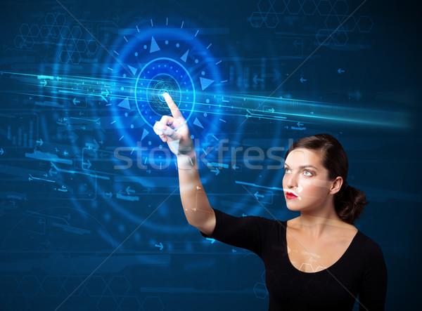 Giovani tech donna alta tecnologia pannello di controllo Foto d'archivio © ra2studio