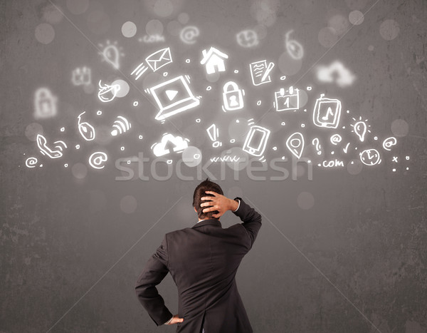 üzletember néz modern ikonok szimbólumok számítógép Stock fotó © ra2studio