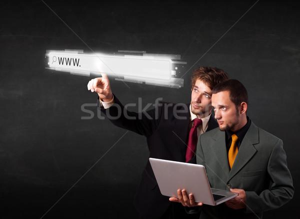 Jóvenes gente de negocios tocar web navegador dirección Foto stock © ra2studio
