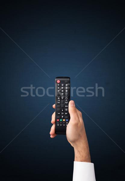 Mão controle remoto azul televisão elétrico Foto stock © ra2studio