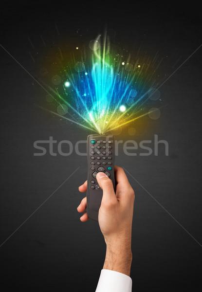 Kéz távirányító robbanékony jel tart ragyogó Stock fotó © ra2studio