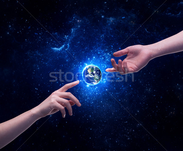 Hands in space touching planet earth Stock photo © ra2studio