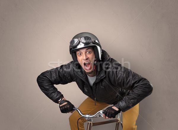 Crazy cyclist with empty background Stock photo © ra2studio
